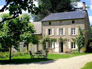Traditional farmhouse with gîtes, camping site and large barns on 2 hectares.