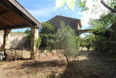 Handsome stone barn and garden for sale in the wine producing village of Camplong