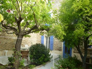 Large stone house with big garage with two floors and courtyard/garden