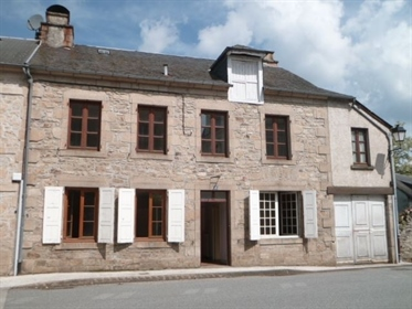 In Corrèze, in a characterful town with all amenities, primary school and college, come an