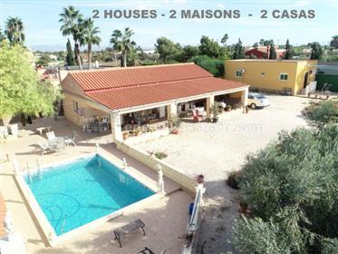 Propiedad con dos casas y con piscina