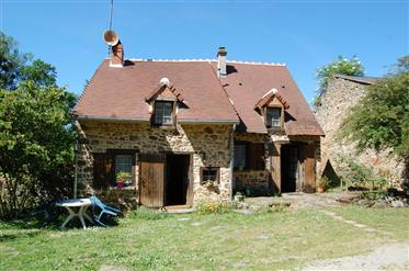 Pretty stone house with 4080m² of garden bordered by a river
