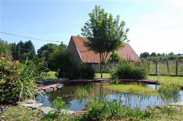 Beautifully presented house in Saint Sulpice Lauriere with 3 barns, garden