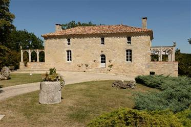 A handsome country property in 10 acres with superb swimming...