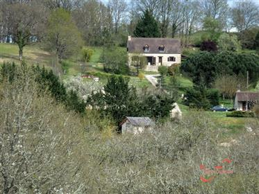A very attractive barn conversion with additions. Set in grounds of 5,305m² with a pool. Exclusive m