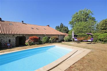 A beautifully renovated, four bedroom stone house for sale with pool and barn