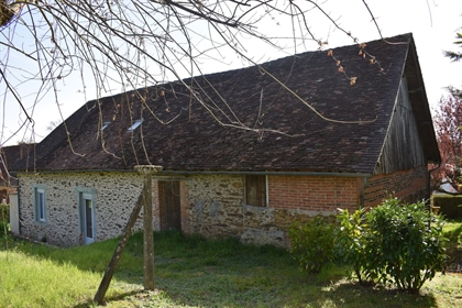 A Stone House With Attached Barn In Lubersac
