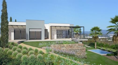 Em construção T1+2 moradias geminadas com piscina perto da praia, Carvoeiro
