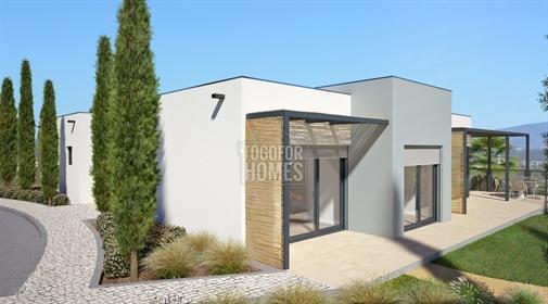 Em construção T1+2 moradias geminadas com piscina perto da p...