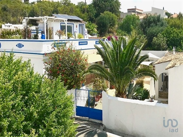 An amazing authentic Portuguese style property in a village atmosphere and with a profitab...