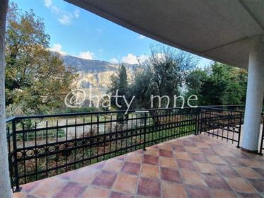 Two bedroom apartment 96m2 with sea view in the town of Prcanj