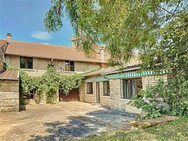 A beautifully renovated house with a large garden and a beau...