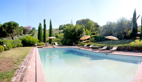 An old stone Farmhouse with garden, pool and panoramic views for sale. The farmhouse is lo