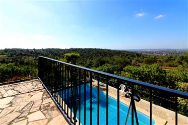 Lovely villa on the edge of a green valley with distant sea ...