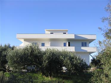 Kato Chorio-Ierapetra:  A three storey house  with a nice sun roof enjoying mountain and sea views.