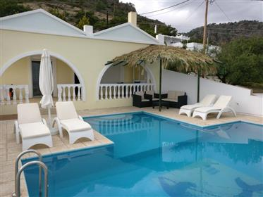A lovely villa of 100m2 on a plot of 2000m2 with stunning mountains and sea views.