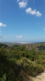 Building plot with nice sea view in the village Zou.