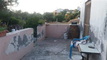 Building plot with a small house and sea view in Trypitos – Sitia.
