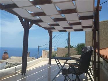 Tourloti-Sitias: Maison en pierre avec une vue fantastique sur la mer et une belle terrasse sur le t