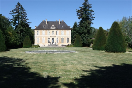 An elegant listed 18th century manor house. Set in 8 hectares with a walled garden and extensive out