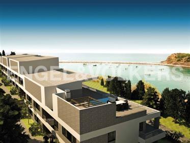 Apartamentos de luxo na 1a linha mar
