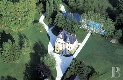 A 17th century castle and its outbuildings with panoramic views, set in 7 hectares of land nested in
