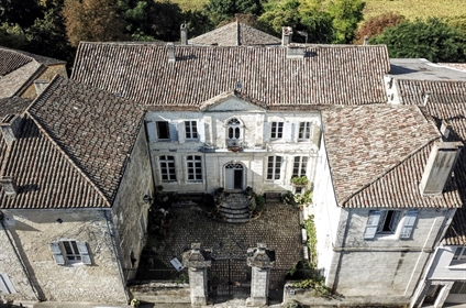 Built in 1770 on the ruins of a medieval castle and forming an interior courtyard the elegant 18th c