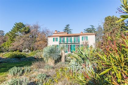 Ideally located this exceptional property built in marble and stone is nestled in a park of 1.4 hect