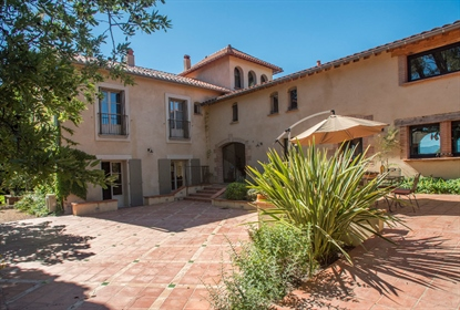 Luxuriously renovated Catalan farmhouse for sale beautifully set in 3.4 hectares walled garden.