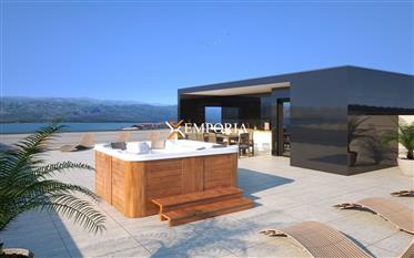 Prekrasan apartman s bazenom i vrtom u prvom redu do mora u Vinjercu