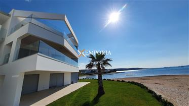 Luxurious, new, modern and in a prime location right by the sea – apartment in Sukošan