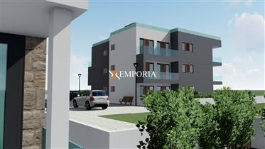 Apartment in the second row to the sea – high quality modern new building – ground floor with garden