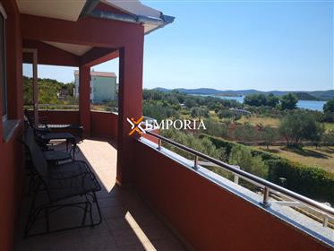 Furnished house with sea views and additional building land,...