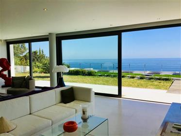 Exceptional recent double villa with panoramic sea view