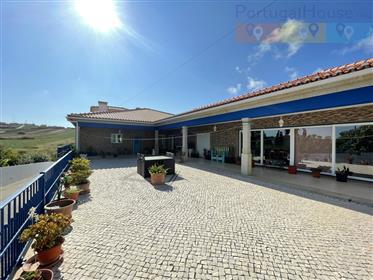 Moradia independente + Armazém de 345 m2 integrado num espaço de 2.522 m2