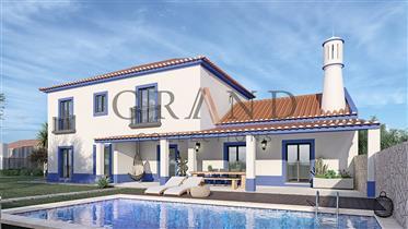 Moradia em construção com piscina e vista mar