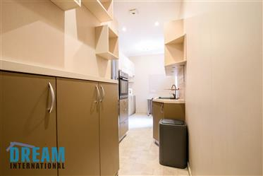 Spacious and bright 4-room apartment for sale in a quiet city center.