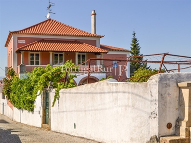 The 'Quinta do Pomarinho' dated 1903, is fully walled, with ...