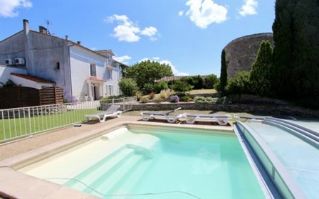 This property, the oldest parts dating from the 18th century, comprises 2 houses, separate