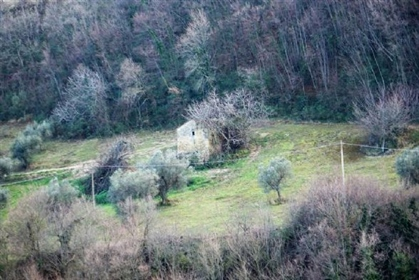 Stone ruin in need of total rebuild on the banks of an artificial lake and with sea views