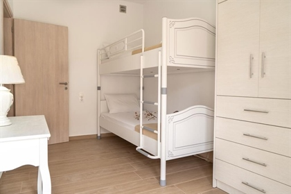 Two bedroom top floor apartment with sea views . Makrigialos.