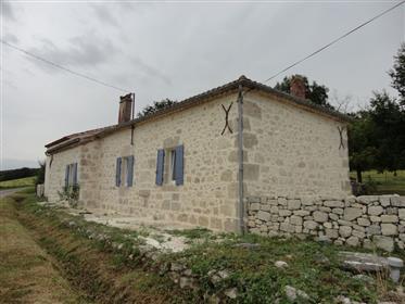Maison en partie en pierre en campagne