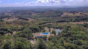 A small modern estate with 6 bedrooms, 2 houses, a truffle plantation, tennis, pool  and complete pe