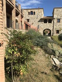 Appartment in picturesque hamlet with private garden and shared pool in the centre of Umbria